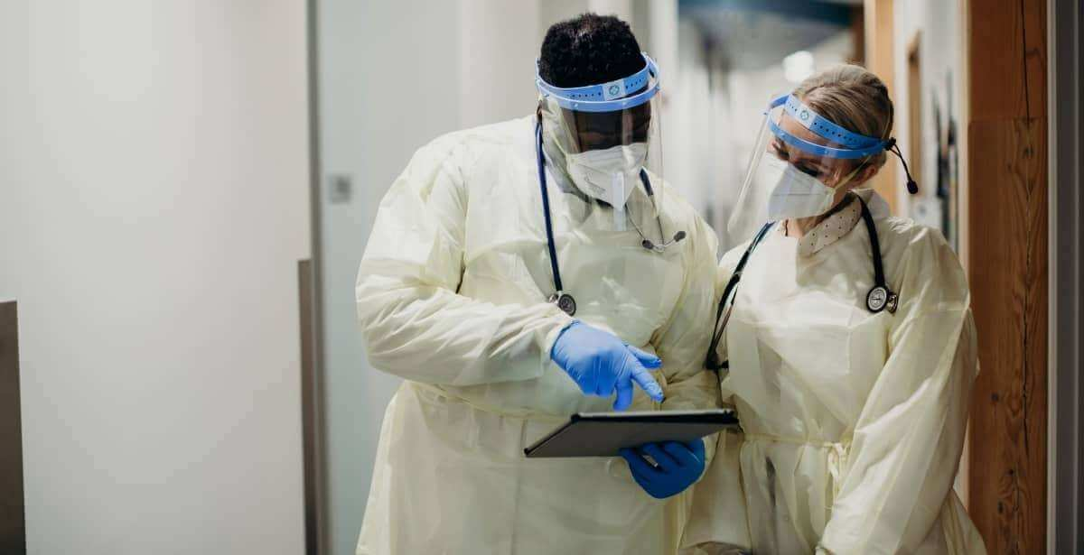Two nurse practitioners wearing PPE