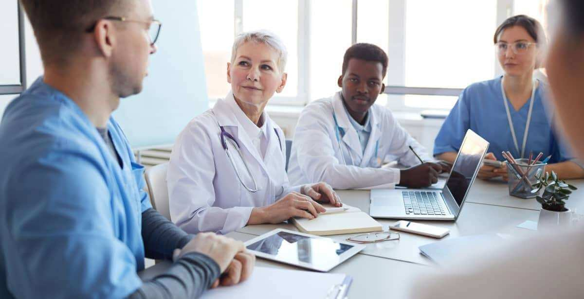 Mature female nurse practitioner heading committee