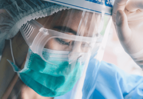 Nurse wearing PPE equipment and mask